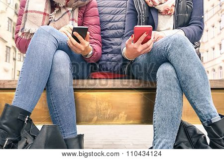 Close Up Of Couple Of Girlfriends In Disinterest Moment With Mobile Smart Phones - Concept Of Relati