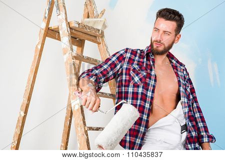 Handsome Painter With Unbottoned Shirt