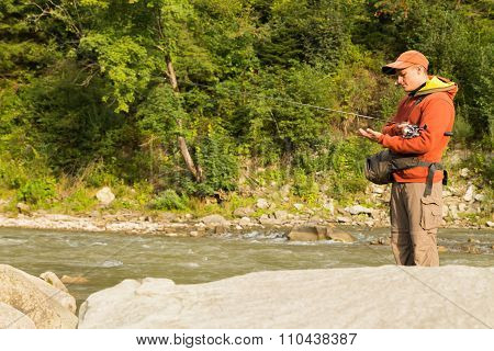 Fishing in the beautiful mountain river.