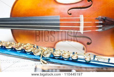 Blue Flute Detail With Violin And Score
