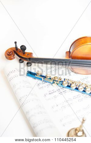 Wood Violin Detail With Blue Flute And Score