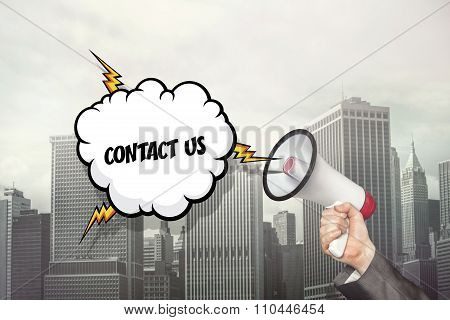Contact us text on speech bubble and businessman hand holding megaphone