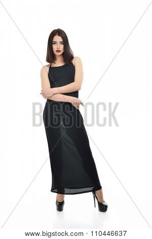 Full-length portrait of young fashion woman in black dress isolated on white background.