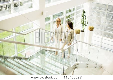 Young Women Walking In The Office
