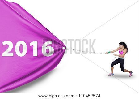 Healthy Woman Pulls Numbers 2016 With Flag