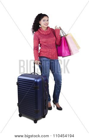 Indian Tourist Carrying Luggage And Shopping Bags