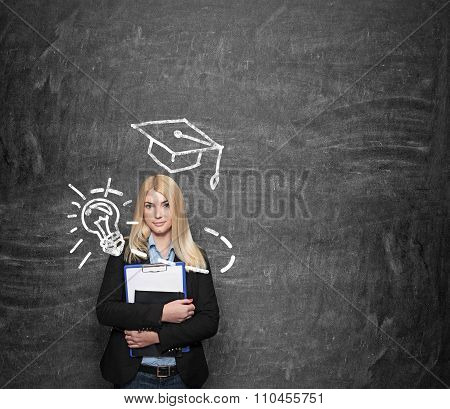 Young Girl Holding Note Book, Drawn Academic Hat Above Her