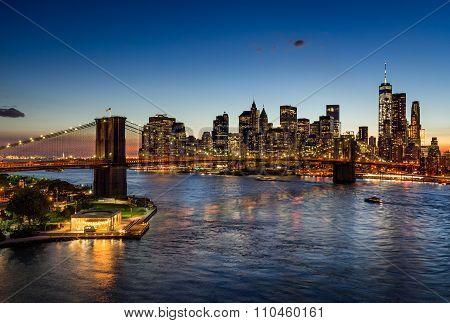 Brooklyn Bridge And Illuminated Manhattan Skyscrapers At Twilight. New York