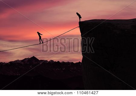 Woman With Courage Walking On The Rope At Mountain