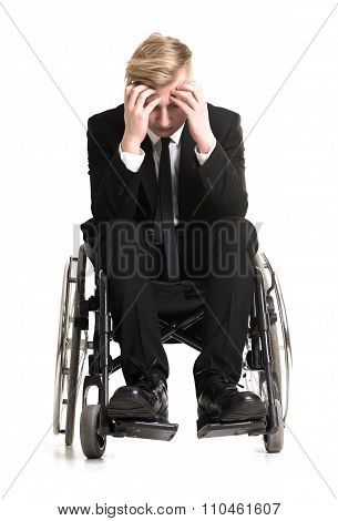 Young Sorrowful Businessman In A Wheelchair