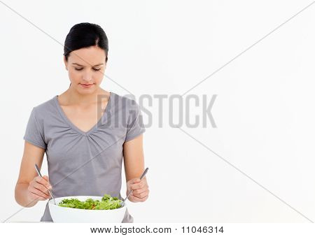Pretty Woman Preparing A Salad With Tomatoes In The Kitchen