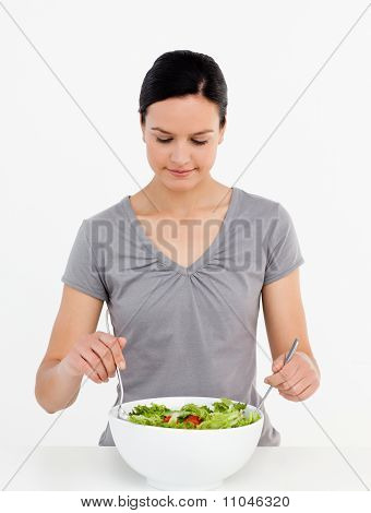 Lovely Woman Mixing A Salad Standing In The Kitchen