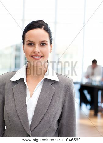 Young Businesswoman Standing In Front Of Her Team