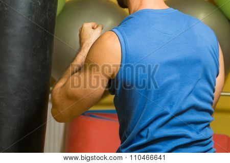 Man in the hall trains hit the punching bag