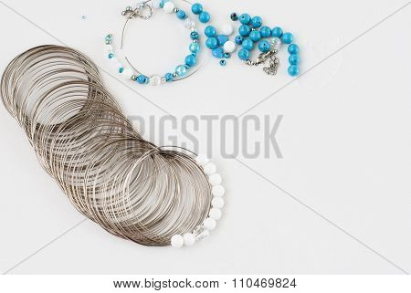 Turquoise and white beads, memory wire for bracelet, tools for creating fashion jewelry in the manuf