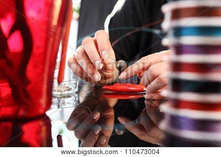 Creating jewelry.