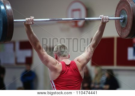 Athlete In His Attempt To Lift The Weights