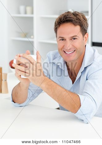 Portrait Of A Man Drinking Coffee In His Kitchen