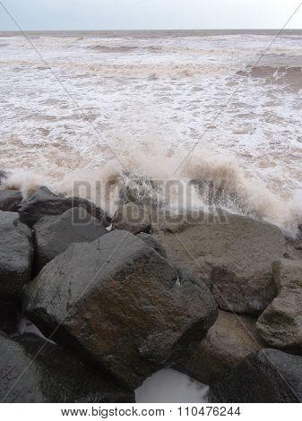Waves Splashing Upon Rocky Seascape