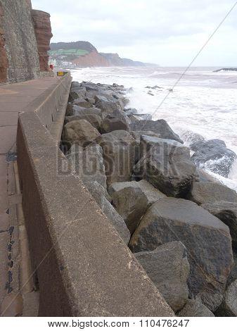 Promenade With Waves Splashing Upon Rocky Seascape