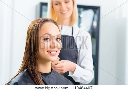 Customer and her stylist in the salon.