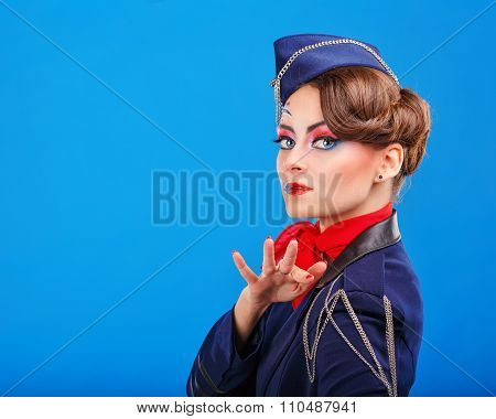 Stewardess Posing With Face Art. Portrait