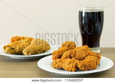 Fried Chicken With Cola On Dining Table