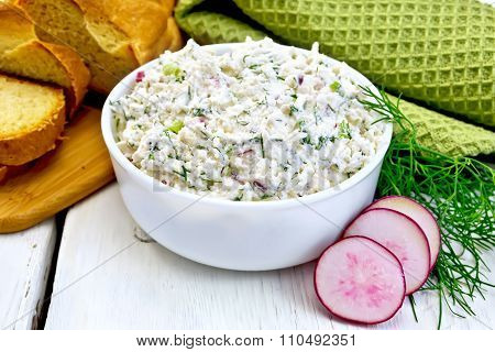 Pate of curd and radish with bread on board