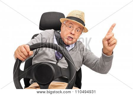 Angry senior holding a steering wheel and cursing and gesturing with his finger isolated on white background