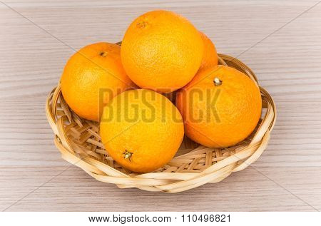 Heap Of Tangerine In Wicker Basket On Table