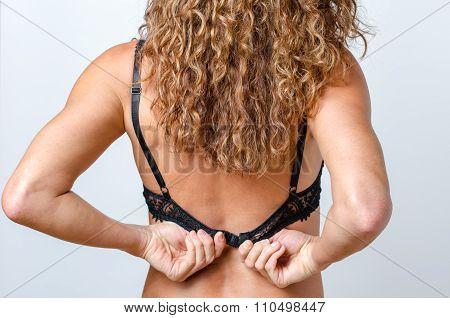 Erotic Woman Pulls Her Bra Off