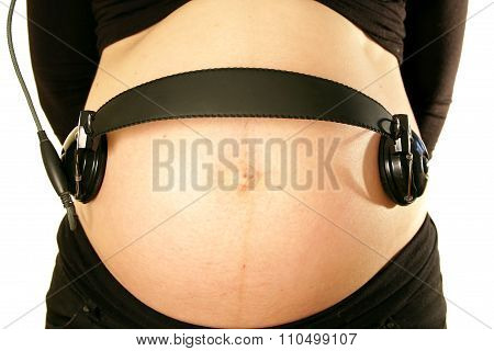 Arms On Pregnant Mommy Belly Tummy Holding Earphones Music For Baby
