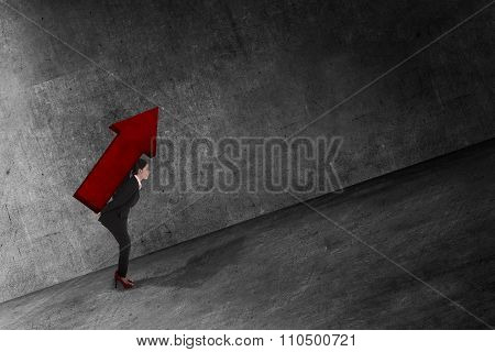Asian Business Woman Carry Big Red Arrow On Her Back