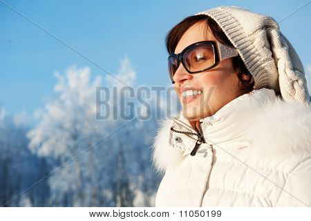 Beautiful young woman enjoying a winter day
