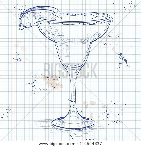 Classic margarita cocktail with lime slice and salty rim on a notebook page