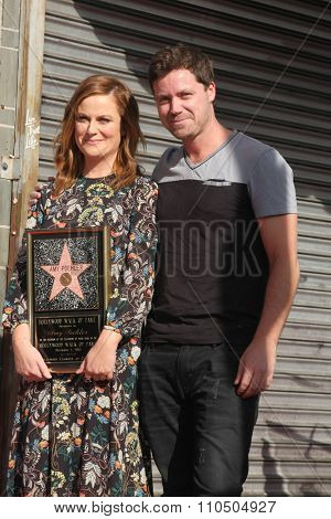 LOS ANGELES - DEC 3:  Amy Poehler, Greg Poehler at the Amy Poheler Hollywood Walk of Fame Ceremony at the Hollywood Blvf on December 3, 2015 in Los Angeles, CA