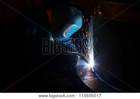 Welder worker is welding