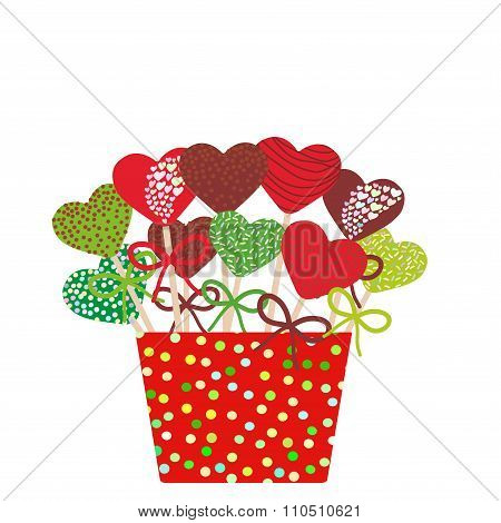 Colorful Sweet heart Cake pops set with bow in a red bucket isolated on white background. Christmas