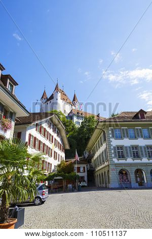 Thun Castle Towering Over The Town Hall Square