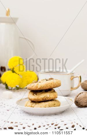 Homemade shortbread cookies with nuts and a cup of tea