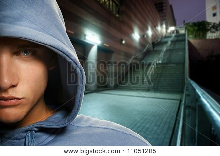Young handsome men in a hood outdoors
