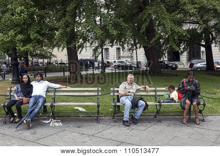 People Of Several Races Sit On Bench In Downtown Manhattan New York City