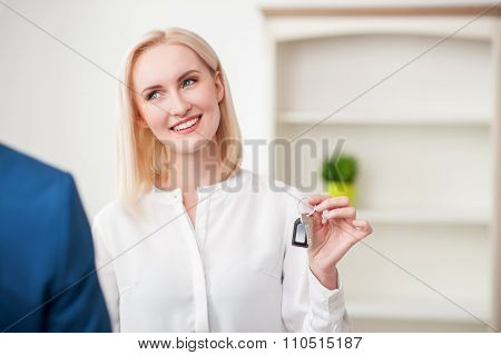 Cheerful blond lady is purchasing a house