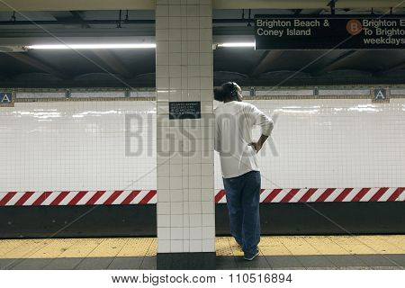 Male African American Waits On Platform Of Subway Station Atlantic Avenue Barclays Ctr