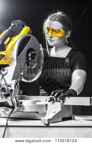 Woman With A Circular Disk Saw