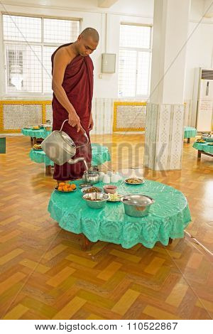 BAGO, MYANMAR - November 26, 2015: Monk serving tea in the monastery from Bago in Myanmar Buddhism in Myanmar is predominantly of the Theravada tradition, practised by 89% of the country's population.