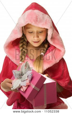 Little beautiful Christmas girl open her present