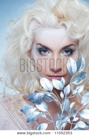 beautiful Snow queen with a magic twig