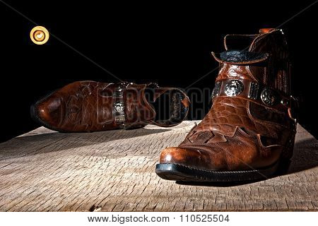 Male boots on the board in moonlight