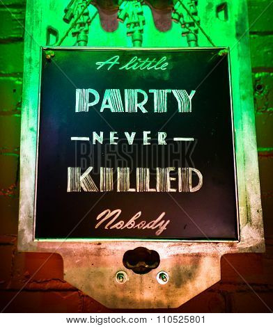 Party sign. A little party never killed anybody.